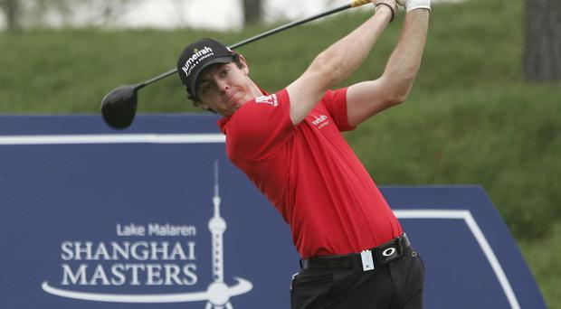 Rory McIlroy of Northern Ireland tees off at Lake Malaren Shanghai Masters golf tournament in Shanghai, China