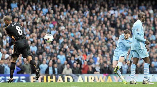 Manchester City's Adam Johnson (centre) shoots to score his team's third goal of the match during the Barclays Premier League match at the Etihad Stadium, Manchester. PRESS ASSOCIATION Photo.