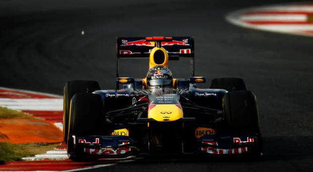 Sebastian Vettel of Germany and Red Bull Racing drives on his way to winning the Indian Formula One Grand Prix at the Buddh International Circuit on October 30, 2011 in Noida, India.