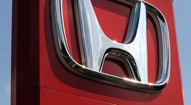 Honda has said quarterly earnings fell 56 per cent compared to the same period of last year