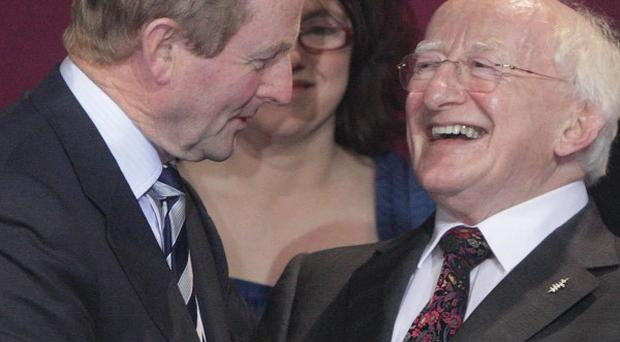 Ireland's President-elect Michael D Higgins is congratulated by Taoiseach Enda Kenny