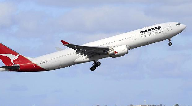 A Qantas jetliner takes off from Sydney Airport after an Australian court ruled on a bitter labour dispute that grounded the whole fleet (AP)