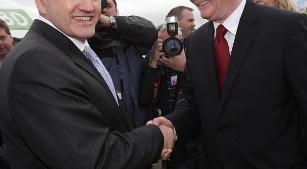 Martin McGuinness, right, said his on-screen clash with fellow presidential candidate Sean Gallagher would go down in political history