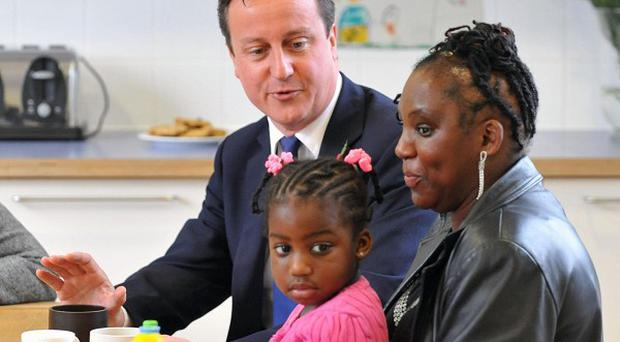 David Cameron speaks with adoptive mothers during a visit to the Archway Children's Centre in north London