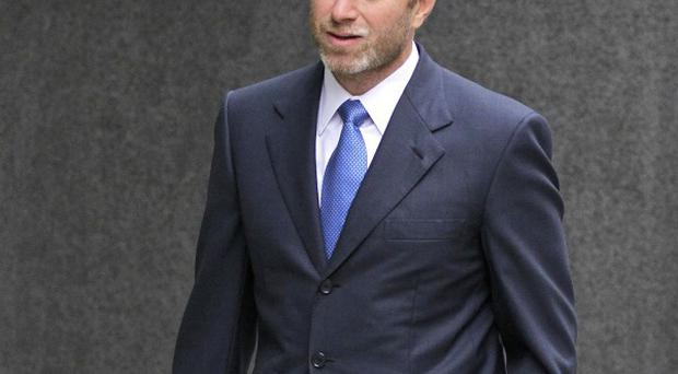 Chelsea FC owner Roman Abramovich has said claims made by a business rival who is suing him for three billion pounds are 'without merit' (AP)