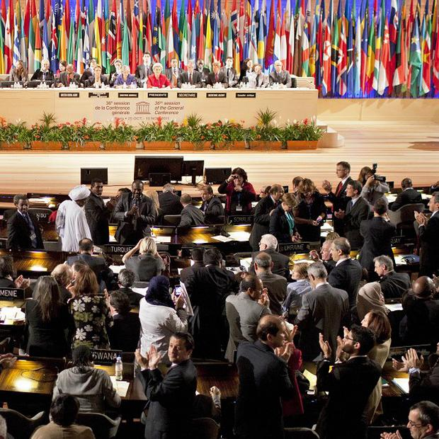 Unesco delegates applaud after approving membership of Palestine in a vote of 107-14 with 52 abstentions(AP)