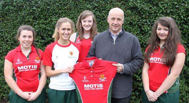 Kitted out: Anna Martin, Kirsty Walker, Keely Mason and Shona McComb get their kit from David McComb