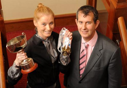 All gold: Former Sports Minister and now Health Minister Edwin Poots with Volunteer Champion Orla Smyth and the five gold medals and Best Senior Athlete Award she won at the British Transplant Games in August