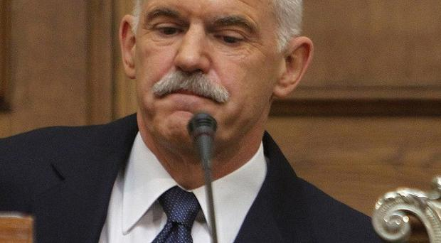 Greek Prime Minister George Papandreou addresses Socialist members of parliament in Athens (AP)