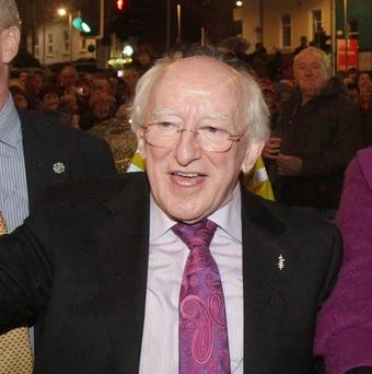 President Michael D Higgins greets the crowds at a homecoming in Galway city