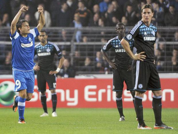 Joy and pain: Genk's Jelle Vossen celebrates after scoring while Fernando Torres shows his dejection last night