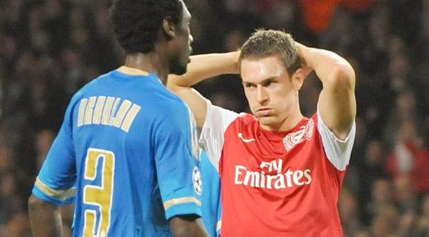 Agony: Arsenal's Aaron Ramsey reacts to a missed header on goal during last night's game with Marseille in the Champions League