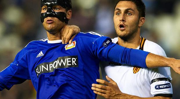 Masked avenger: Michael Ballack wore a mask during Bayer Leverkusen's defeat in Valencia last night to protect a broken nose