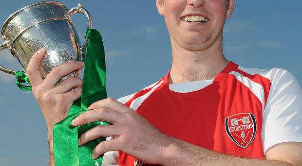 Happier days: Godfrey Irwin with the Irish Senior Cup but the Cookstown captain has been sidelined with a fractured skull