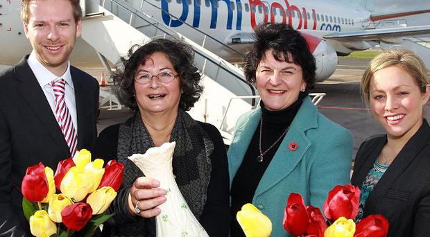 Ingrid Haye (second left) receives a vase from Arlene Foster as Belfast City airport marks first direct service to Europe (William Cherry/Presseye)