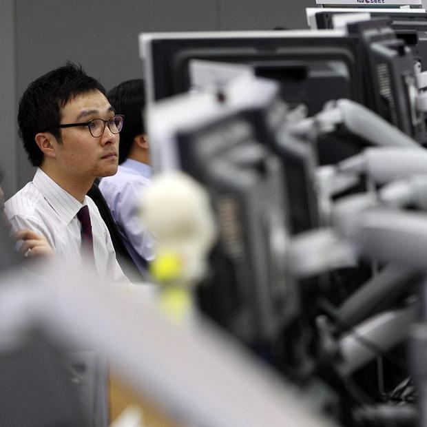 A currency trader watches monitors at the Korea Exchange Bank headquarters in Seoul (AP)
