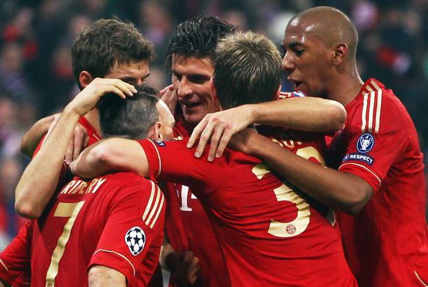 All together now: Bayern Munich's Mario Gomez is congratulated by Thomas Mueller, Franck Ribery, Toni Kroos and Jerome Boateng