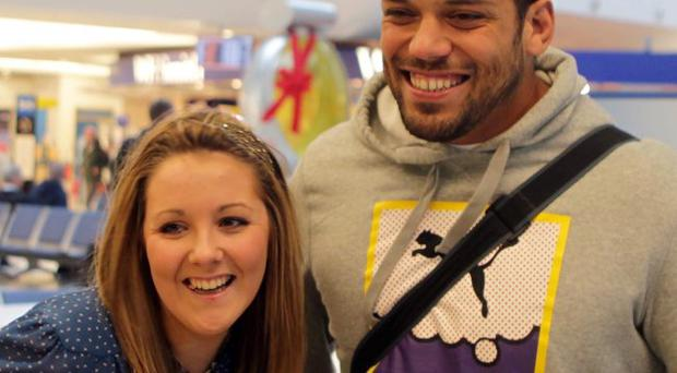 Touchdown: Ulster's new prop John Afoa is welcomed at George Best City Airport by fan Rebecca Tonner