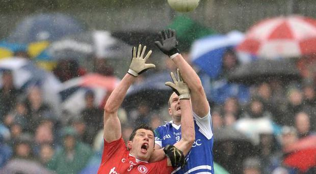 Tyrone's Sean Cavanagh (left) in an aerial dual with Monaghan's Owen Lennon