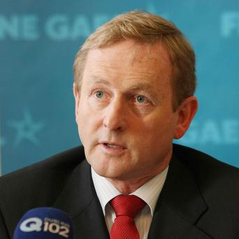Enda Kenny has denied going back on promises over paying the debt of Anglo Irish Bank