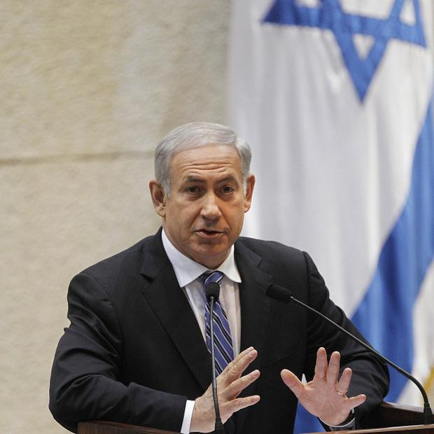 Israeli prime minister Benjamin Netanyahu says a nuclear-armed Iran would pose a 'dire threat' to the world (AP)