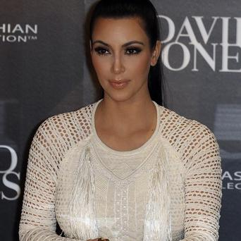 Kim Kardashian at the launch of her fashion accessory range at a department store in Sydney