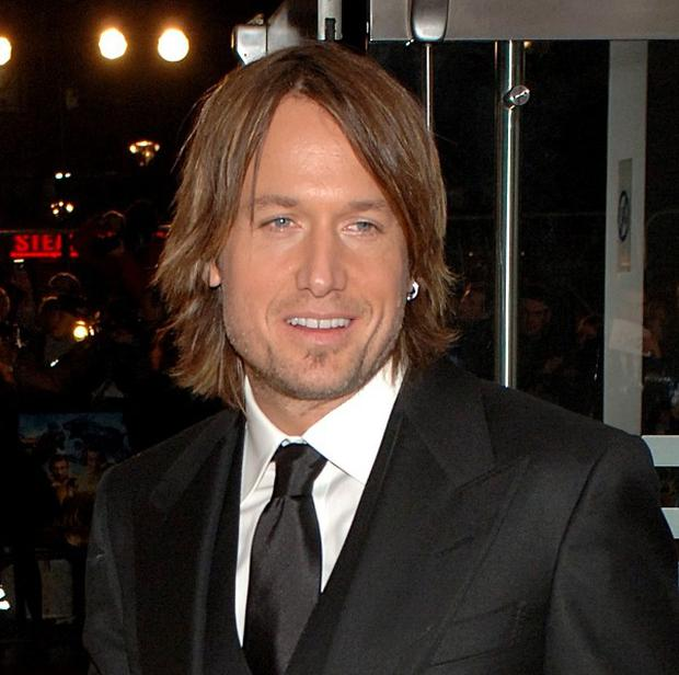 Singer Keith Urban is to undergo throat surgery