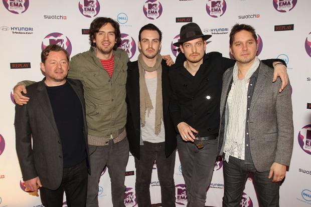 BELFAST, NORTHERN IRELAND - NOVEMBER 06: (L to R) Paul Wilson, Gary Lightbody, Tom Simpson, Jonny Quinn and Nathan Connolly of Snow Patrol attend the MTV Europe Music Awards 2011 at the Odyssey Arena on November 6, 2011 in Belfast, Northern Ireland. (Photo by Dave J Hogan/Getty Images)