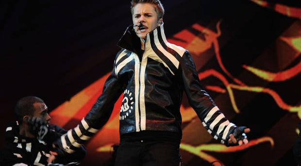 BELFAST, NORTHERN IRELAND - NOVEMBER 06: Justin Bieber performs onstage during the MTV Europe Music Awards 2010 live show at at the Odyssey Arena on November 6, 2011 in Belfast, Northern Ireland. (Photo by Dave Benett/Getty Images)