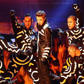 Justin Bieber performs during the 2011 MTV Europe Music Awards in Belfast