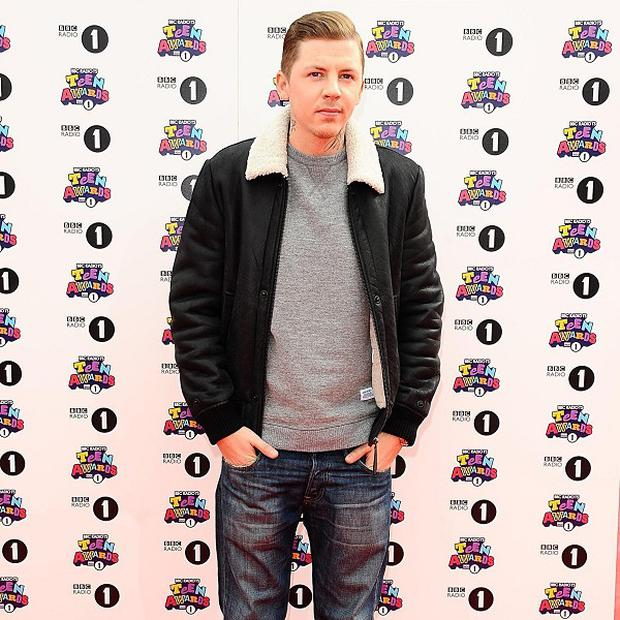 Professor Green has retained top slot in the singles charts
