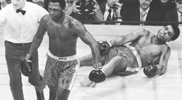 March 8, 1971, file photo, shows boxer Joe Frazier being directed to the ropes by referee Arthur Marcante after knocking down Muhammad Ali during the 15th round of the title bout at Madison Square Garden in New York.