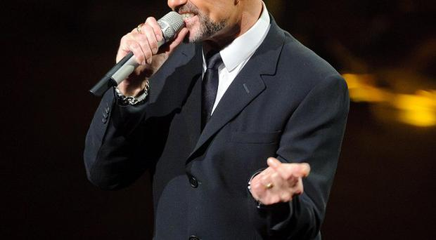 George Michael performing on stage at the Royal Opera House in Covent Garden in aid of the Elton John Aids Foundation
