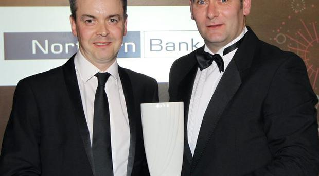 Michael McLaughlin, Marketing Manager for Northern Bank, is pictured with Peter-Fyffle McFadden, Kantar Media, after Northern Bank won the award for Best Brand Development Campaign Ð Large Company at the CIM Ireland Marketing Excellence Awards.