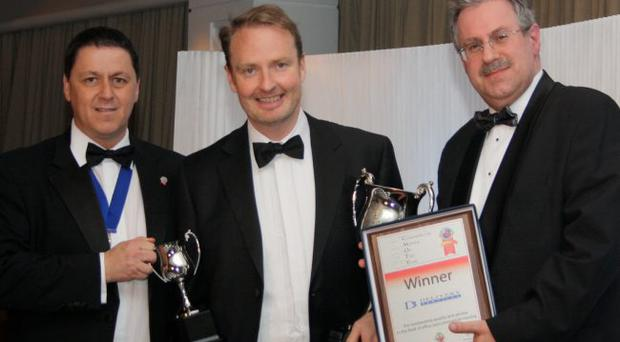 Richard Hill, Managing Director, Delivery Services (centre), receives the 'Commercial Remover of the Year 2011' award from Neil Rodgers, Chairman, Commercial Moving Group (left) and Paul Bullock, of sponsor Teacrate PLC