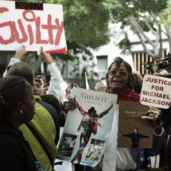Michael Jackson fans celebrated outside court after Dr Conrad Muray was found guilty of the star's involuntary manslaughter
