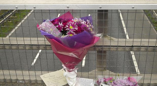 Floral tributes across the M5 in Somerset, close to where a 34-vehicle pile-up which claimed seven lives