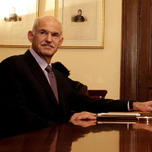 George Papandreou held a third day of power sharing talks (AP)