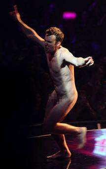 A streaker appears onstage as Hayden Panettiere is presenting at the MTV Europe Music Awards 2011 at the Odyssey Arena in Belfast.