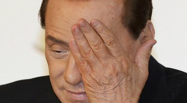 Silvio Berlusconi's has pledged to resign once economic reforms are passed (AP)
