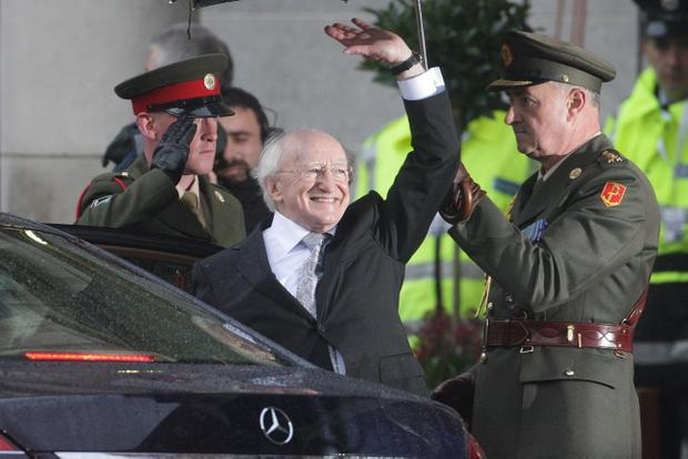President Michael D Higgins waves to cheering school children after his inauguration ceremony as Ireland's ninth head of state at Dublin Castle yesterday.