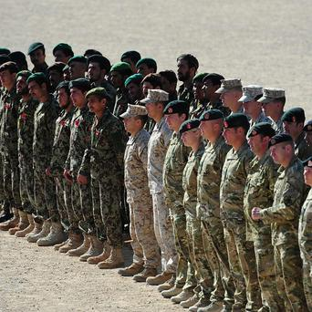 British and Afghan troops standing side by side at Camp Shorabak, Helmand Province