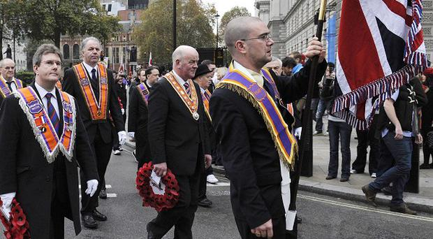 Members of the Protestant Orange Order commemorate Remembrance weekend with a parade through Westminster