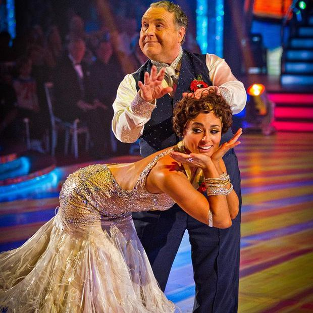 Russell Grant and Flavia Cacace from BBC's Strictly Come Dancing, which tied with ITV's X Factor over viewer figures (BBC/PA)
