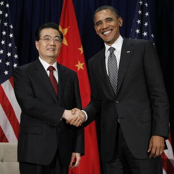Barack Obama shakes hands with Chinese president Hu Jintao at the APEC Summit in Honolulu (AP)
