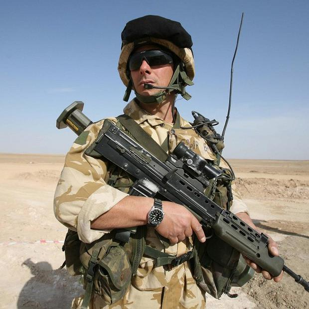 Hundreds of British soldiers will remain in Afghanistan after the UK pulls troops out of fighting roles