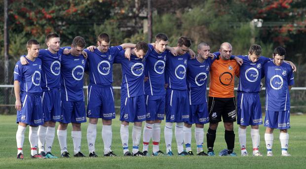 First Division HW Welders v Loughgall, Loughgall observe a minutes silence for Remembrance Day.