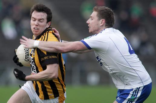 Ballinderry's Declan Bell tries to tackle Crossmaglen's Tony Kernan during yesterday's match