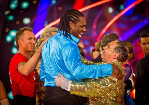 Russell waltzes with boxer Audley Harrison, who was voted out of the show last night