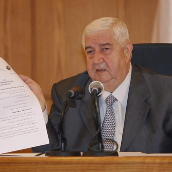 Syrian Foreign Minister Walid al-Moallem who has accused Arab states of conspiring against Damascus after the Arab League voted to suspend Syria's membership(AP)